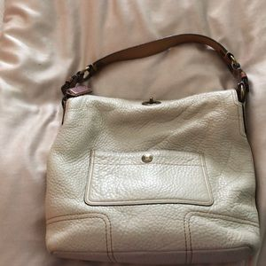 White peoples leather Coach bag